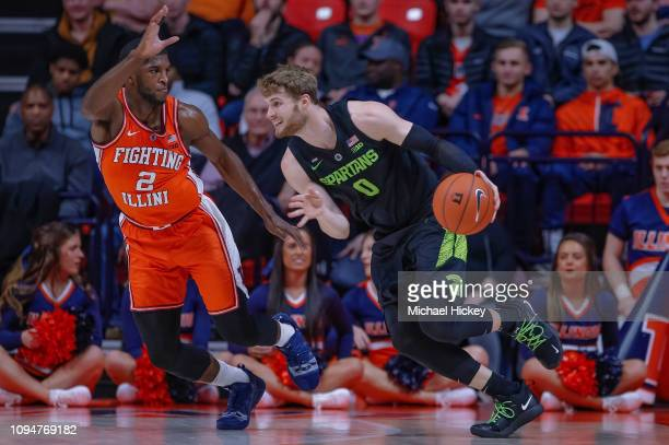 Kyle Ahrens of the Michigan State Spartans dribbles the ball against Kipper Nichols of the Illinois Fighting Illini at State Farm Center on February...