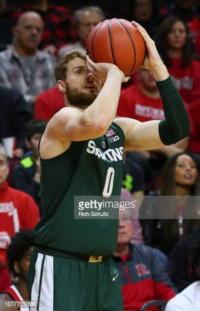Kyle Ahrens of the Michigan State Spartans in action against the Rutgers Scarlet Knights during a college basketball game at the Rutgers Athletic...