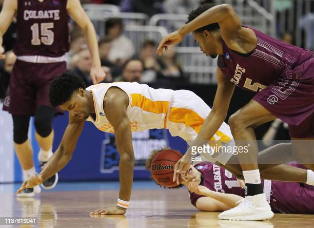 Kyle Alexander of the Tennessee Volunteers battles for a loose ball during the first half against the Colgate Raiders in the first round of the 2019...