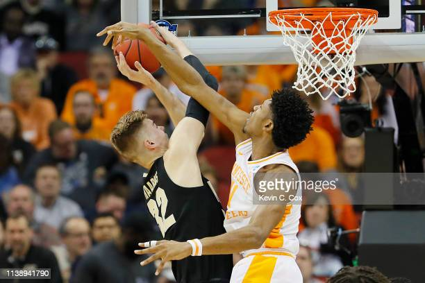 Kyle Alexander of the Tennessee Volunteers blocks a shot by Matt Haarms of the Purdue Boilermakers during the first half of the 2019 NCAA Men's...