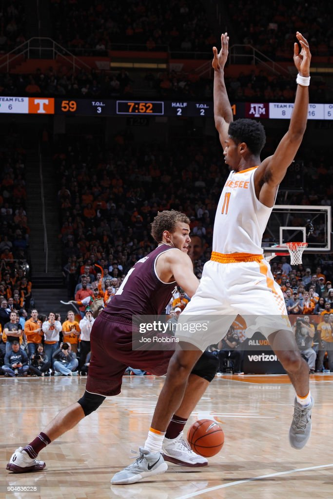 Kyle Alexander #11 of the Tennessee Volunteers defends against DJ Hogg #1 of the Texas A&M Aggies in the second half of a game at Thompson-Boling Arena on January 13, 2018 in Knoxville, Tennessee. Tennessee won 75-62.