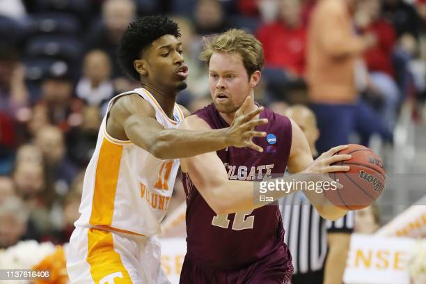 Kyle Alexander of the Tennessee Volunteers defends Dana Batt of the Colgate Raiders during the first half in the first round of the 2019 NCAA Men's...