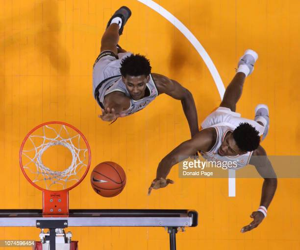Kyle Alexander of the Tennessee Volunteers shoots over Jaylen Hoard of the Wake Forest Demon Deacons during their game at Thompson-Boling Arena on...
