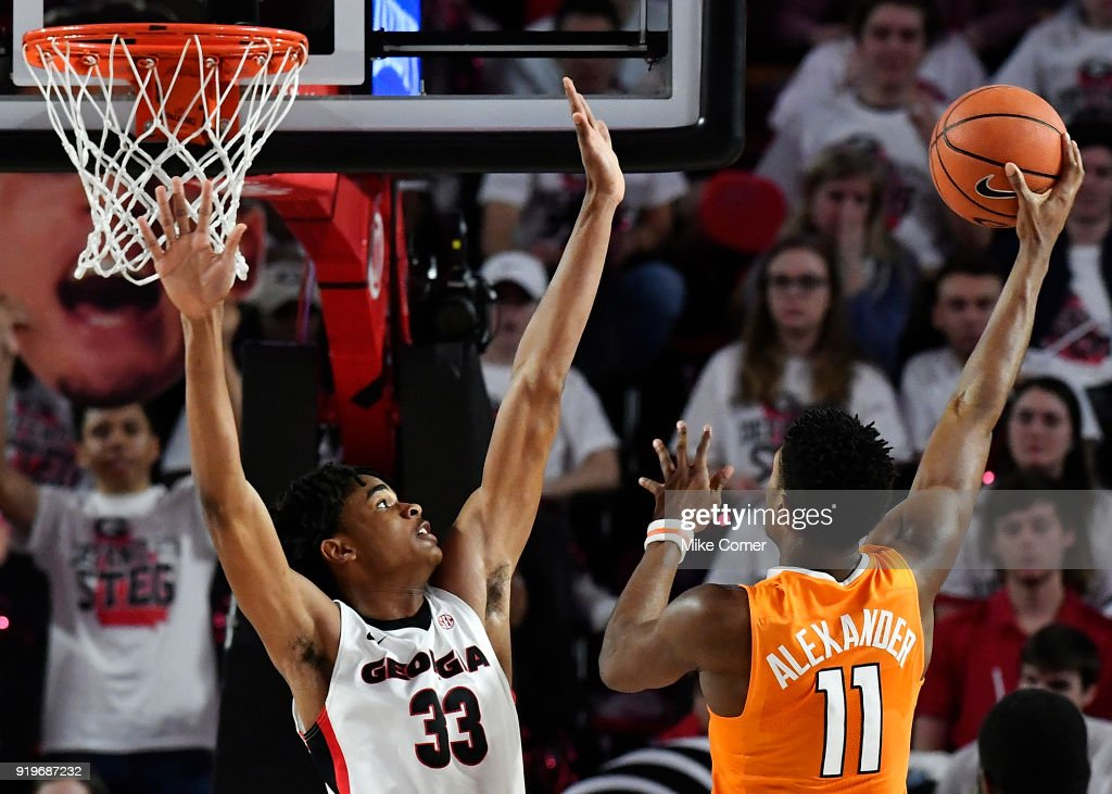 Kyle Alexander #11 of the Tennessee Volunteers shoots over Nicolas Claxton #33 of the Georgia Bulldogs during the basketball game at Stegeman Coliseum on February 17, 2018 in Athens, Georgia.
