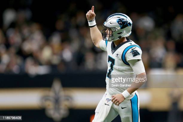 Kyle Allen of the Carolina Panthers celebrates a touchdown scored by Christian McCaffrey against the New Orleans Saints during the second quarter in...