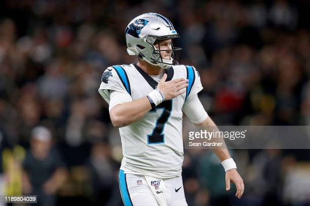 Kyle Allen of the Carolina Panthers celebrates a touchdown scored by Christian McCaffrey against the New Orleans Saints during the third quarter in...