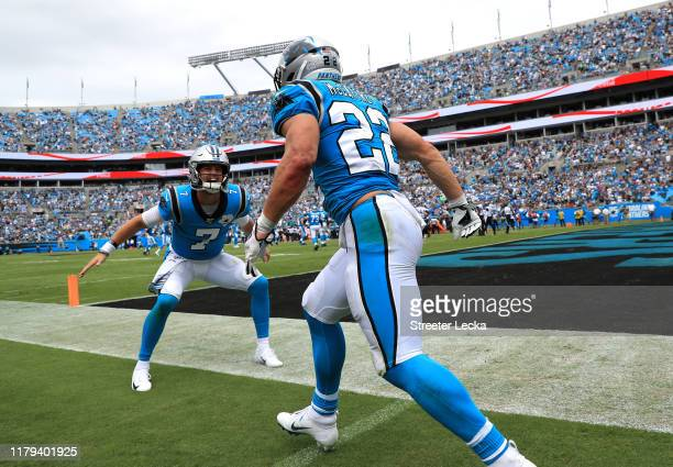 Kyle Allen of the Carolina Panthers celebrates with teammate Christian McCaffrey after McCaffrey scores a touchdown during their game against the...