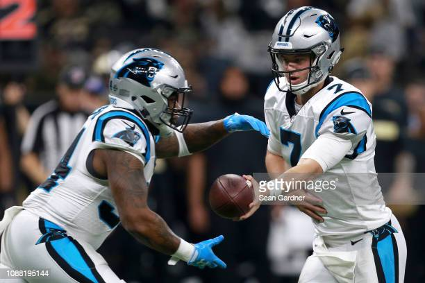 Kyle Allen of the Carolina Panthers hands the ball to Cameron ArtisPayne during the first half against the New Orleans Saints during a NFL game at...