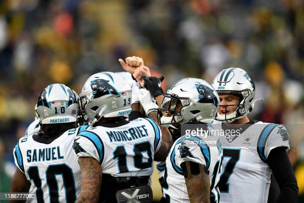 Kyle Allen of the Carolina Panthers huddles with his teammates Curtis Samuel, Donte Moncrief and D.J. Moore during warms up prior to the game against...