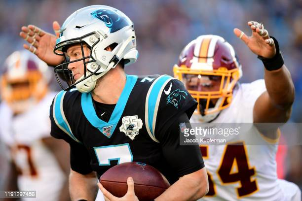 Kyle Allen of the Carolina Panthers is pressured by Myles Humphrey of the Washington Redskins during the third quarter during their game at Bank of...