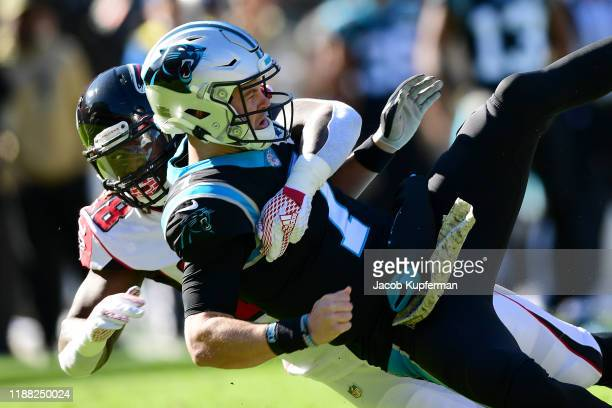 Kyle Allen of the Carolina Panthers is pressured by Takkarist McKinley of the Atlanta Falcons during the first quarter during their game at Bank of...