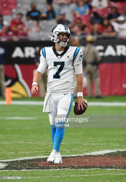 Kyle Allen of the Carolina Panthers laughs while holding the ball during a game against the Arizona Cardinals at State Farm Stadium on September 22...
