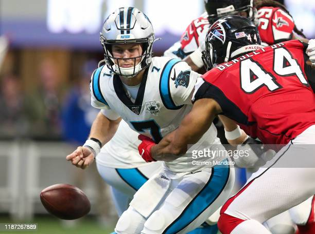 Kyle Allen of the Carolina Panthers looks to throw under pressure from Vic Beasley of the Atlanta Falcons during the second half of the game at...