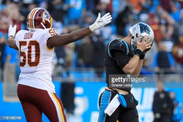 Kyle Allen of the Carolina Panthers reacts after his last play on offense as Chris Odom of the Washington Redskins watches on during their game at...