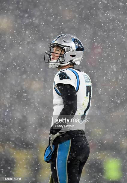 Kyle Allen of the Carolina Panthers reacts as snow falls against the Green Bay Packers in the game at Lambeau Field on November 10 2019 in Green Bay...