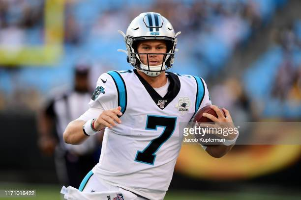 Kyle Allen of the Carolina Panthers runs with the ball during their preseason game against the Pittsburgh Steelers at Bank of America Stadium on...