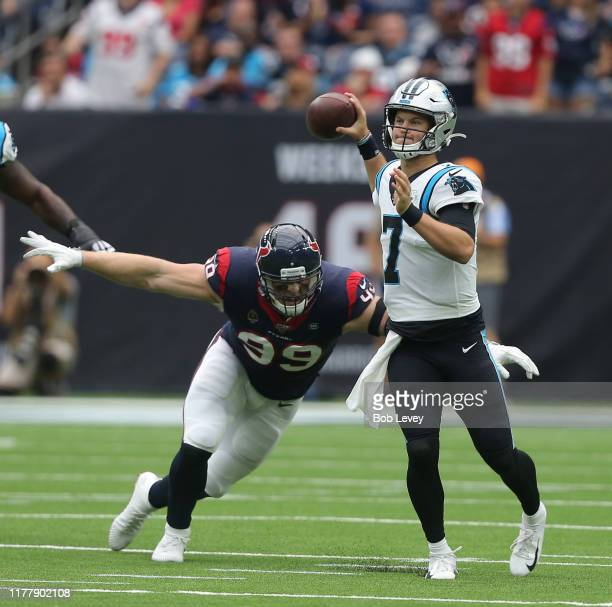 Kyle Allen of the Carolina Panthers scrambles out of the pocket pressured by JJ Watt of the Houston Texans during the first half at NRG Stadium on...