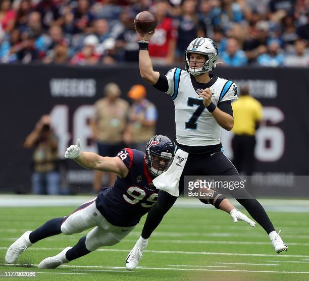 Kyle Allen of the Carolina Panthers scrambles out of the pocket looking for a receiver as he is pressured by JJ Watt of the Houston Texans during the...