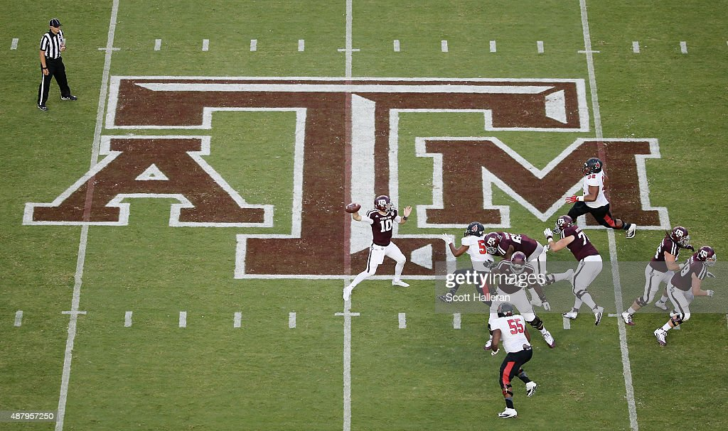 Kyle Allen #10 of the Texas A&M Aggies drops back to pass in the first half of their game against the Ball State Cardinals at Kyle Field on September 12, 2015 in College Station, Texas.