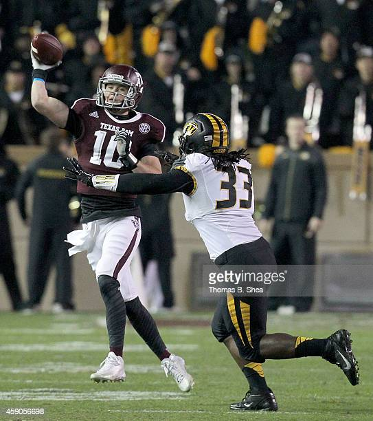 Kyle Allen of the Texas AM Aggies throws the ball while being pressured by Markus Golden of the Missouri Tigers n the first half in a NCAA football...