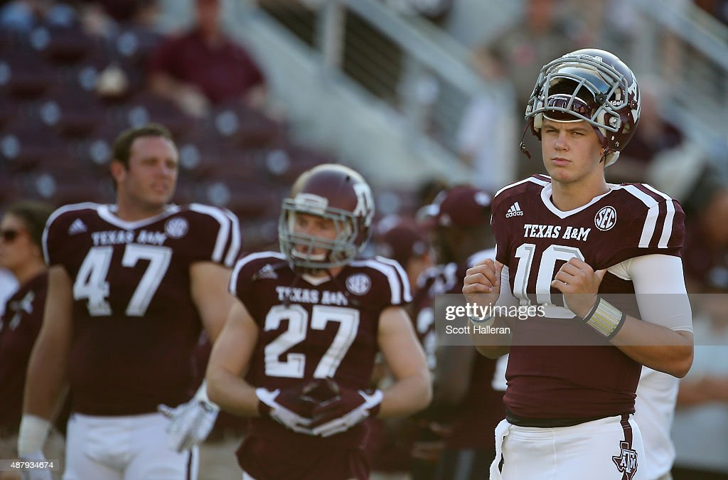 Kyle Allen #10 of the Texas A&M Aggies waits with his teammates on the field before the start of their game against the Ball State Cardinals at Kyle Field on September 12, 2015 in College Station, Texas.