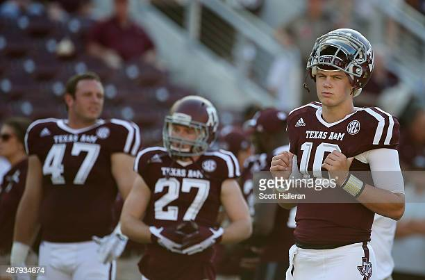 Kyle Allen of the Texas A&M Aggies waits with his teammates on the field before the start of their game against the Ball State Cardinals at Kyle...