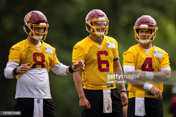 Kyle Allen, Steven Montez, and Taylor Heinicke of the Washington Football Team participate in a drill during mandatory minicamp at Inova Sports...