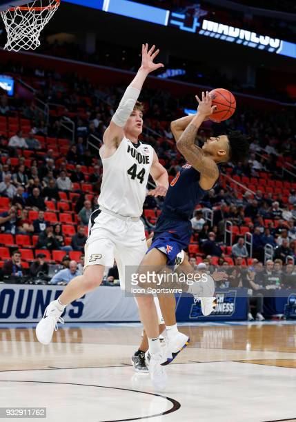 Kyle Allman of the Cal State Fullerton Titans goes up for a shot around C Isaac Haas of the Purdue Boilermakers during the NCAA Division I Men's...