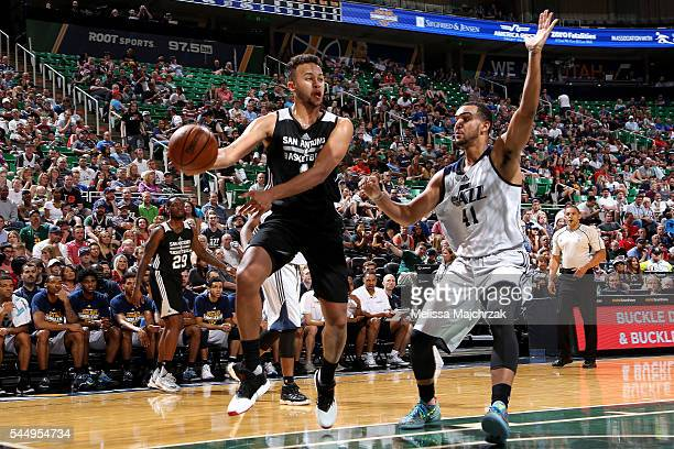 Kyle Anderson of San Antonio Spurs handles the ball during the game against Trey Lyles of Utah Jazz during the 2016 NBA Utah Summer League on July 4...