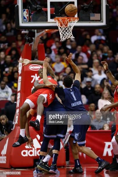 Kyle Anderson of the Memphis Grizzlies drives to the basket on Gary Clark of the Houston Rockets at Toyota Center on December 31 2018 in Houston...