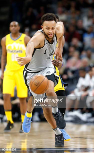 Kyle Anderson of the San Antonio Spurs after a steal gets a clear path foul from Emmanuel Mudiay of the Denver Nuggets at ATT Center on January 13...