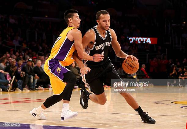 Kyle Anderson of the San Antonio Spurs drives past Jeremy Lin of the Los Angeles Lakers at Staples Center on November 14 2014 in Los Angeles...