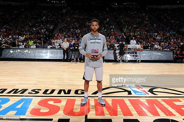Kyle Anderson of the San Antonio Spurs poses with the NBA Summer League MVP Award during the game against the Phoenix Suns during the Las Vegas...
