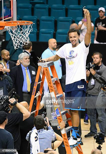Kyle Anderson of the UCLA Bruins cuts down a net after defeating the Arizona Wildcats 7571 in the championship game of the Pac12 Basketball...