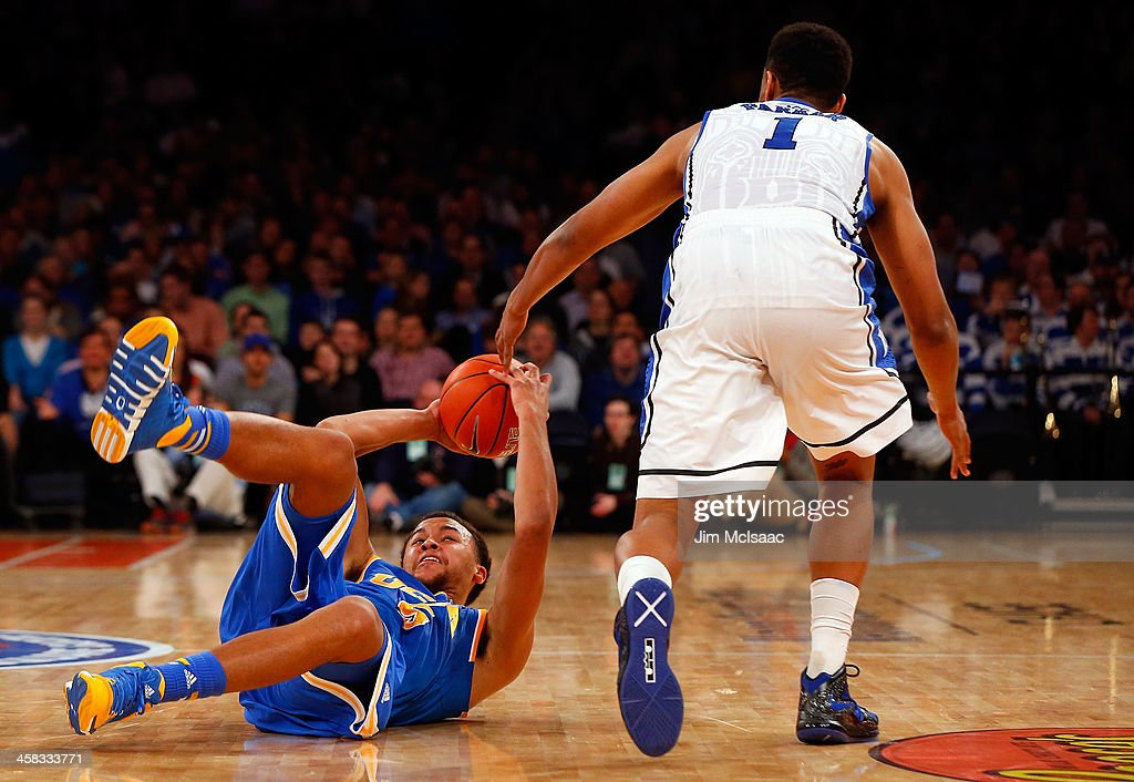 Kyle Anderson #5 of the UCLA Bruins in action against Jabari Parker #1 of the Duke Blue Devils during the CARQUEST Auto Parts Classic on December 19, 2013 at Madison Square Garden in New York City. Duke defeated UCLA