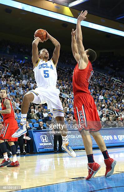 Kyle Anderson of the UCLA Bruins shoots over Aaron Gordon of the Arizona Wildcats at Pauley Pavilion on January 9 2014 in Los Angeles California