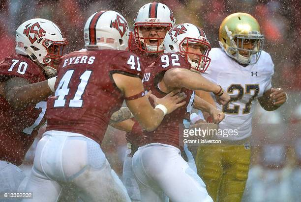 Kyle Bambard of the North Carolina State Wolfpack celebrates with teammates after kicking a field goal against the Notre Dame Fighting Irish during...