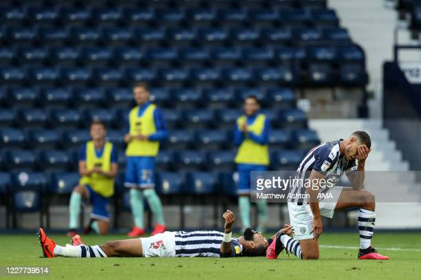 Kyle Bartley and Jake Livermore of West Bromwich Albion react after conceding the first goal during the Sky Bet Championship match between West...