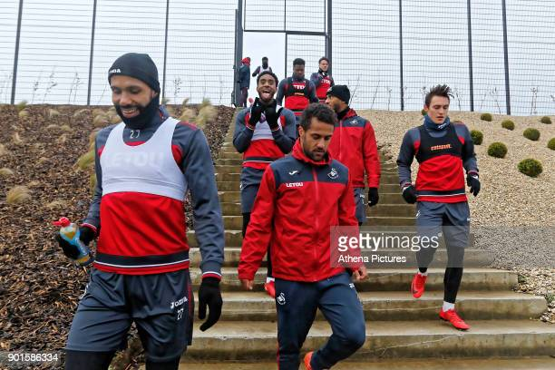 Kyle Bartley Leroy Fer Wayne Routledge Luciano Narsingh Connor Roberts walk to the training pitch during the Swansea City Training at The Fairwood...