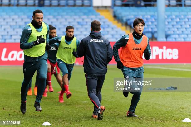 Kyle Bartley of and Ki SungYueng of Swansea City warm up prior to the game during The Emirates FA Cup Fifth Round match between Sheffield Wednesday...