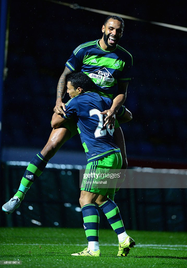 Kyle Bartley of Swansea City celebrates scoring a goal with Jefferson Montero during the Pre Season Friendly match between Reading and Swansea City at Adams Park on July 24, 2015 in High Wycombe, England.