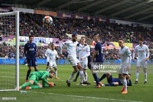 Kyle Bartley of Swansea City clears the ball after a goalmouth scramble during the Emirates FA Cup Quarter Final match between Swansea City and...
