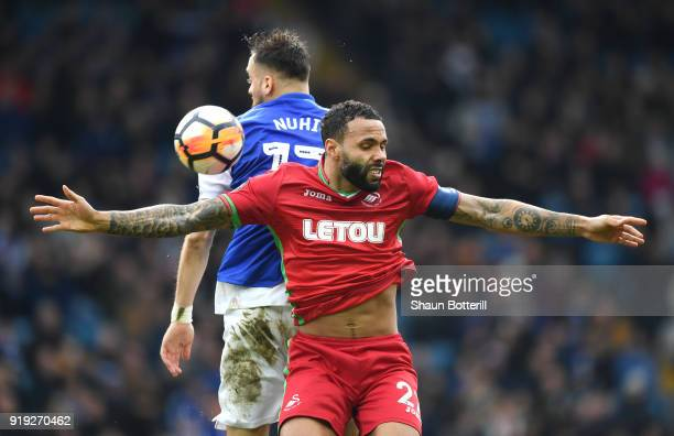 Kyle Bartley of Swansea City competes for the ball with Atdhe Nuhiu of Sheffield Wednesday during the The Emirates FA Cup Fifth Round between...