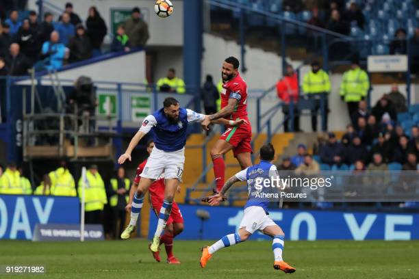Kyle Bartley of Swansea City heads the ball away from Atdhe Nuhiu of Sheffield Wednesday during The Emirates FA Cup Fifth Round match between...