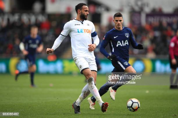 Kyle Bartley of Swansea City in action with Erik Lamela of Tottenham Hotspur during the Emirates FA Cup Quarter Final match between Swansea City and...