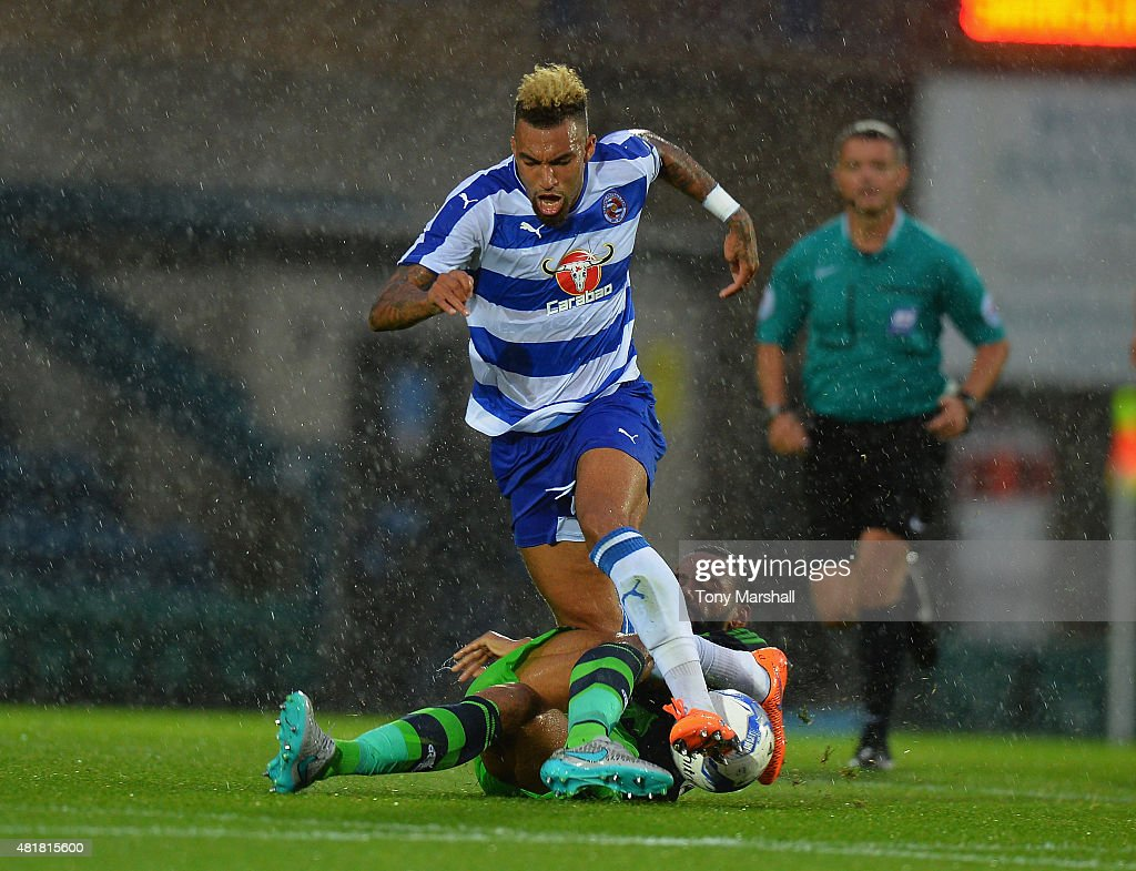 Kyle Bartley of Swansea City tackles Danny Williams of Reading during the Pre Season Friendly match between Reading and Swansea City at Adams Park on July 24, 2015 in High Wycombe, England.