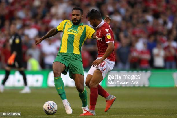 Kyle Bartley of West Bromwich Albion and Joao Carvalho of Nottingham Forest during the Sky Bet Championship match between Nottingham Forest v West...