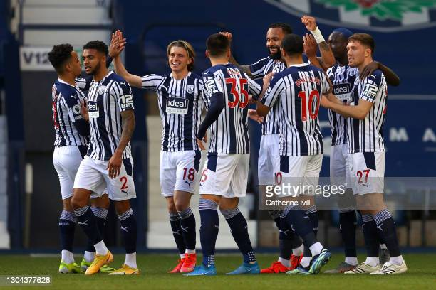 Kyle Bartley of West Bromwich Albion celebrates with teammates after scoring his team's first goal during the Premier League match between West...