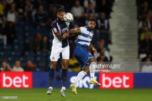 Kyle Bartley of West Bromwich Albion competes with Andre Gray of Queens Park Rangers during the Sky Bet Championship match between West Bromwich...
