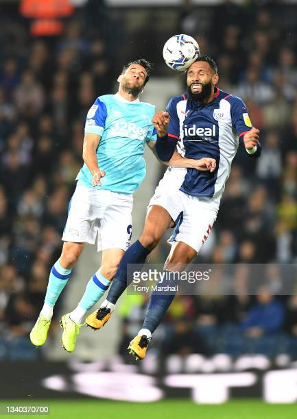 Kyle Bartley of West Bromwich Albion is challenged by Sam Baldock of Derby County during the Sky Bet Championship match between West Bromwich Albion...